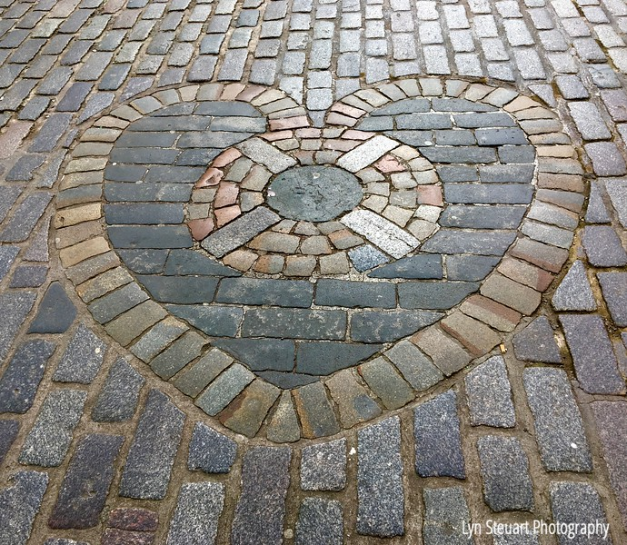 Heart of Midlothian outside St Giles Cathedral on the Royal Mile - looks can be deceiving since this is the sight of the entrance of the Old Tollbooth prison & site of executions dating back to the 14th century!  Locals spit on this site - certainly not a romantic site!!