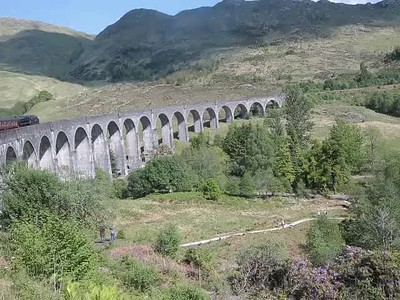 Hogwart train travelling across the famous viaduct in one of the Harriet Potter movies.