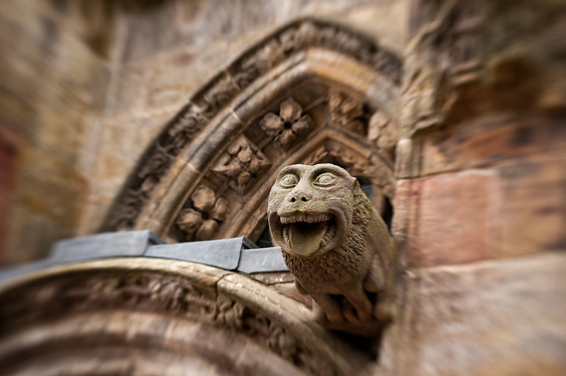 A gargoyle overlooking and protecting the entrance to Rosslyn Chapel.