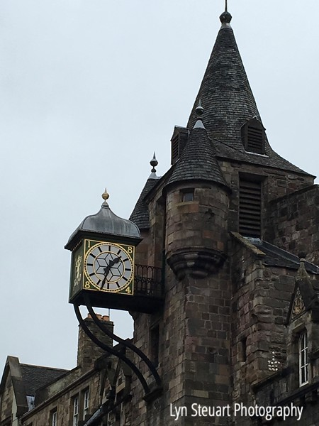 Clock above the Tolbooth Tavern on the Royal Mile in Edinburgh.