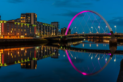Reflection view of The Clyde Arc in Glasgow at dusk.