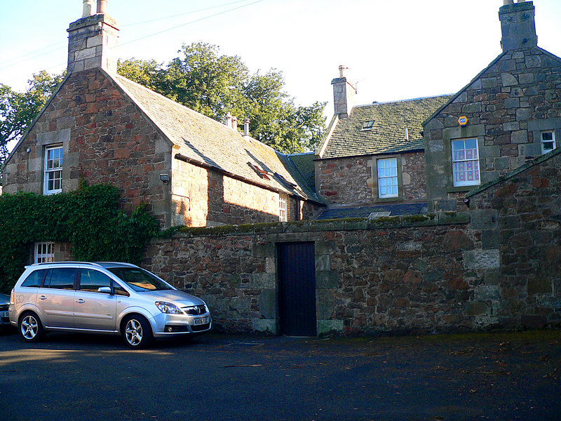 Drem, Scotland. The ell on the left was our Bothy in Drem.  The main B&B was the Farmhouse, but ours was a separate two-story building, connected by a door into the kitchen of the B&B.  Beautiful and fun.  Through the blue door is our private courtyard.