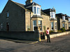 Our Nairn house; the end of a quiet street: great views of the parkland from both sets of bay windows.  A bench out front for us spectators.