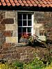 Drem, Scotland.  More farm outbuildings, made into pretty cottages.  Flowers everywhere.