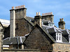 More chimney pots in St. Andrews.  One pot for each room's fire, I guess.   I'm told they now have central heating and the chimneys are decorative.