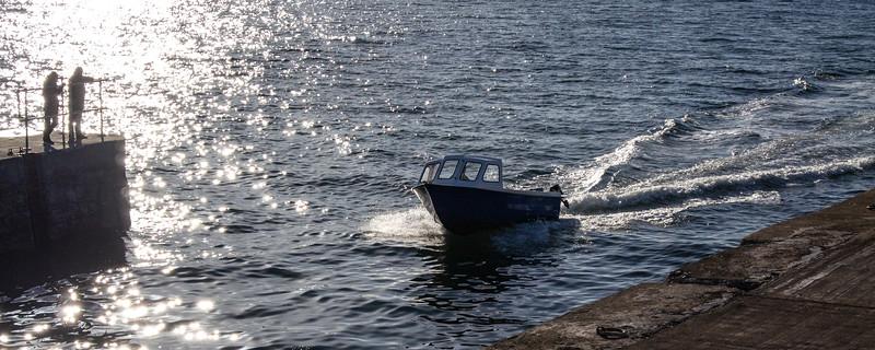 Fishing boat entering Hopeman Harbour
