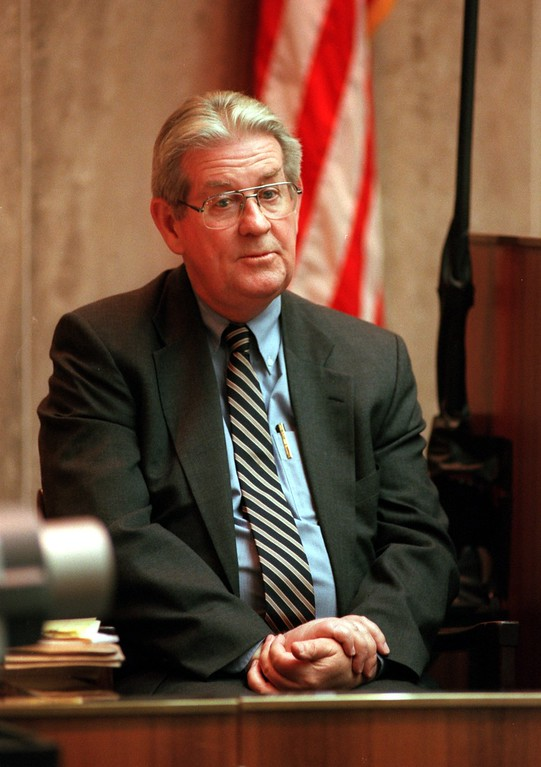 ". Doctor Bernard Carrol testifies on his medical background and qualifications during the $50 million wrongful death suit brought by the family of Scott Amedure against ""The Jenny Jones Show\"" in Oakland County Circuit Court in Pontiac, Mich., Wednesday April 7, 1999.  The Amedure\'s family is suing the show distributor Warner Bros. and producer Telepictures Productions contending the show\'s \'ambush\' TV tactics drove Jonathan Schmitz to shoot Amedurein 1995 (AP Photo The Oakland Press, Charlie Cortez, Pool)"