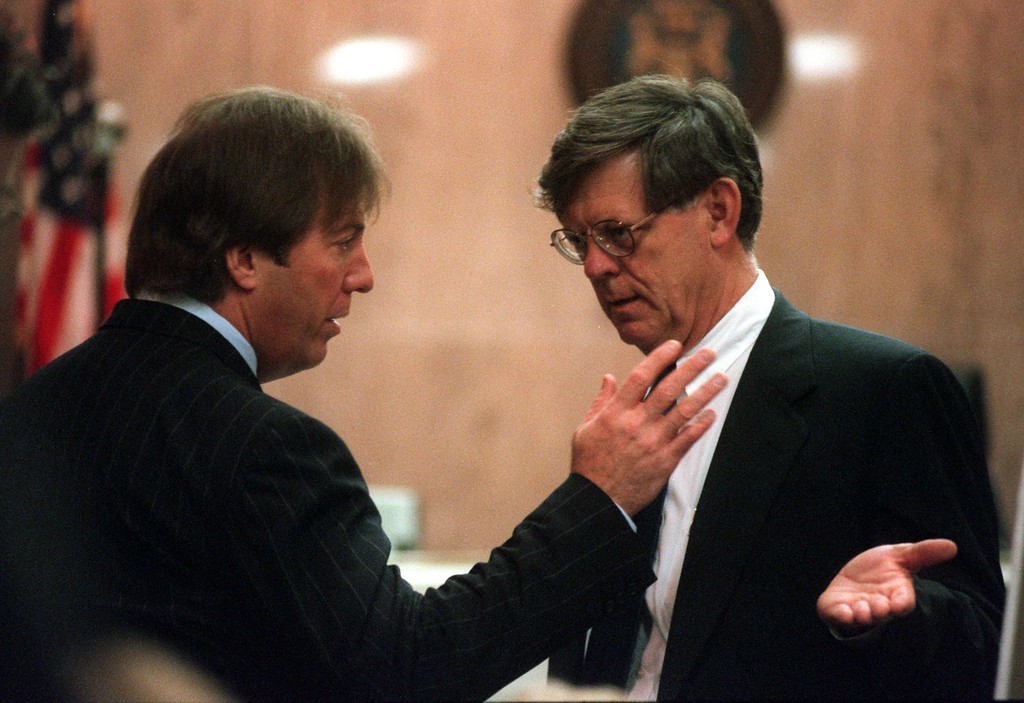 . Geoffrey Fieger (left,) attorney for the family of Scott Amedure  and  Jim George, attorney for Warner Bros. and The Jenny Jones Show, confer during a break in   the trial of a $50 million wrongful death suit brought by the family of Scott Amedure against \'The Jenny Jones Show,\' in Oakland County Circuit Court in Pontiac, Mich., Friday, April 9, 1999.  Amedure\'s family is suing the show, distributor Warner Bros. and producer Telepicture Productions contending the show\'s \'ambush\' TV tactics drove Jonathan Schmitz to shoot Amedure.