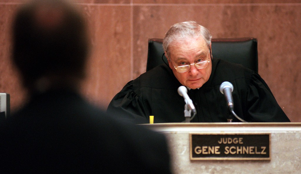 . Judge Gene Schnelz listens to attorney Geoffrey Fieger, left,  during the trial of a $50 million wrongful death suit brought by the family of Scott Amedure against \'The Jenny Jones Show,\' in Oakland County Circuit Court in Pontiac, Mich., Friday, April 9, 1999. (AP Photo/Charlie Cortez, Pool)