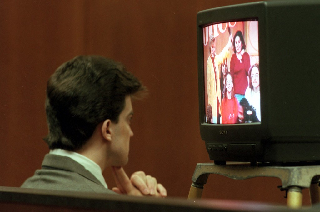 . Jonathon Schmitz, left, sits in Oakland County Circuit Court as he watches a taping of Jenny Jones during his trail for killing Scott Amedure in 1996.