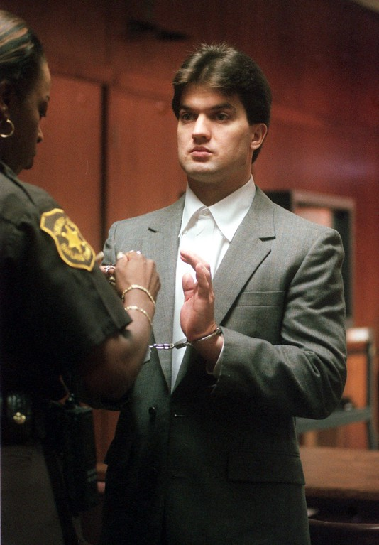 . Jonathan Schmitz has his handcuffs removed by an Oakland County Sheriff\'s deputy before the start of his retrial in the murder of Scott Amedure in Oakland County Circuit Thursday August 19, 1999. Schmitz shot and killed Amedure on March 9, 1995 a few days after it was revealed Amedure had a crush on Schmitz while both appeared on the Jenny Jones Show.
