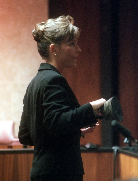 . Oakland Prosecutor Donna Pendergast, during her opening arguement, shows the jury the shotgun Jonathan Schmitz used to shoot and kill Scott Amedure on March 9, 1995 a few days after it was revealed Amedure had a crush on Schmitz while both appeared on the Jenny Jones Show. In a retrial in front of Oakland County Circuit Judge Wendy Potts,  Schmitz is attempting to have his second degree murder charge dropped to manslaughter.
