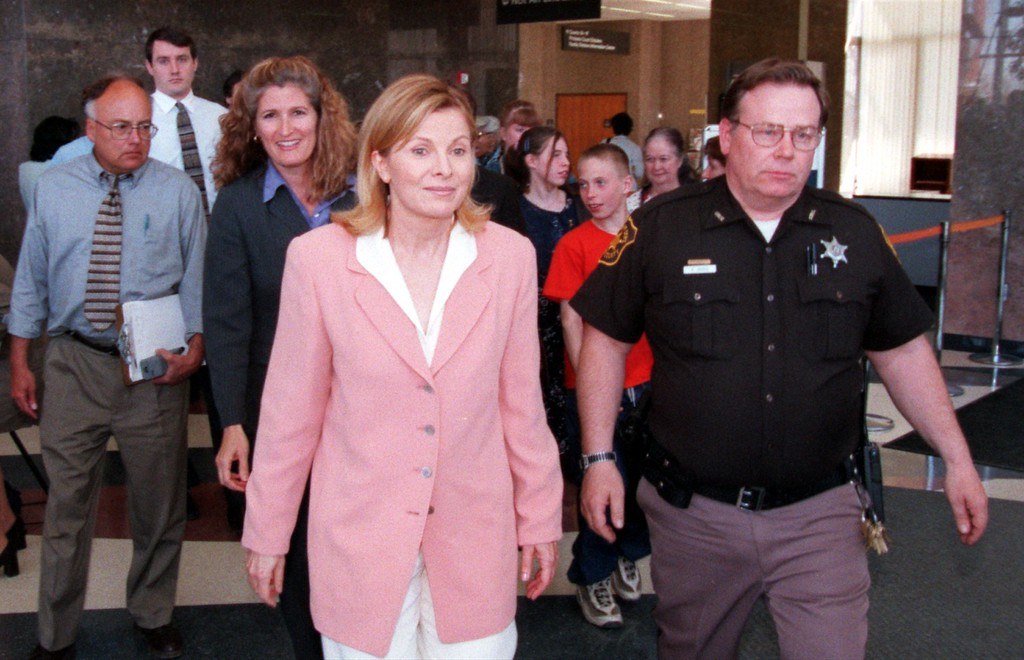 . Talk show host Jenny Jones, center, is escorted out of the Oakland County Courthouse after three days of testimony during the $50 million wrongful-death suit brought by the family of Scott Amedure against The Jenny Jones Show in Oakland County Circuit Court in Pontiac, Mich., Wednesday  April 14, 1999. The Amedure\'s family is suing the show distributor Warner Bros. and producers Telepictures Production contending the show\'s ambush TV tactics drove Jonathan Schmitz to shoot Amedure 1995. (AP Photo/Charlie Cortez, Pool)