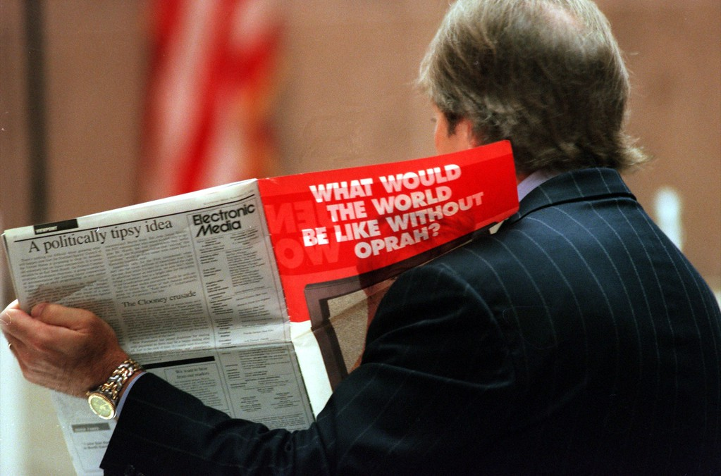 . Geoffrey Fieger, attorney for the family of Scott Amedure holds up a magazine during questioning of executive producer Ed Glavin from \'The Jenny Jones Show\' during his testimony in Oakland County Circuit Court, Ponitac, Mich., April 23, 1999 during the trial of a $50 million wrongful death suit brought by the family of Scott Amedure against \'The Jenny Jones Show\'. (AP Photo/Charlie Cortez, Pool)