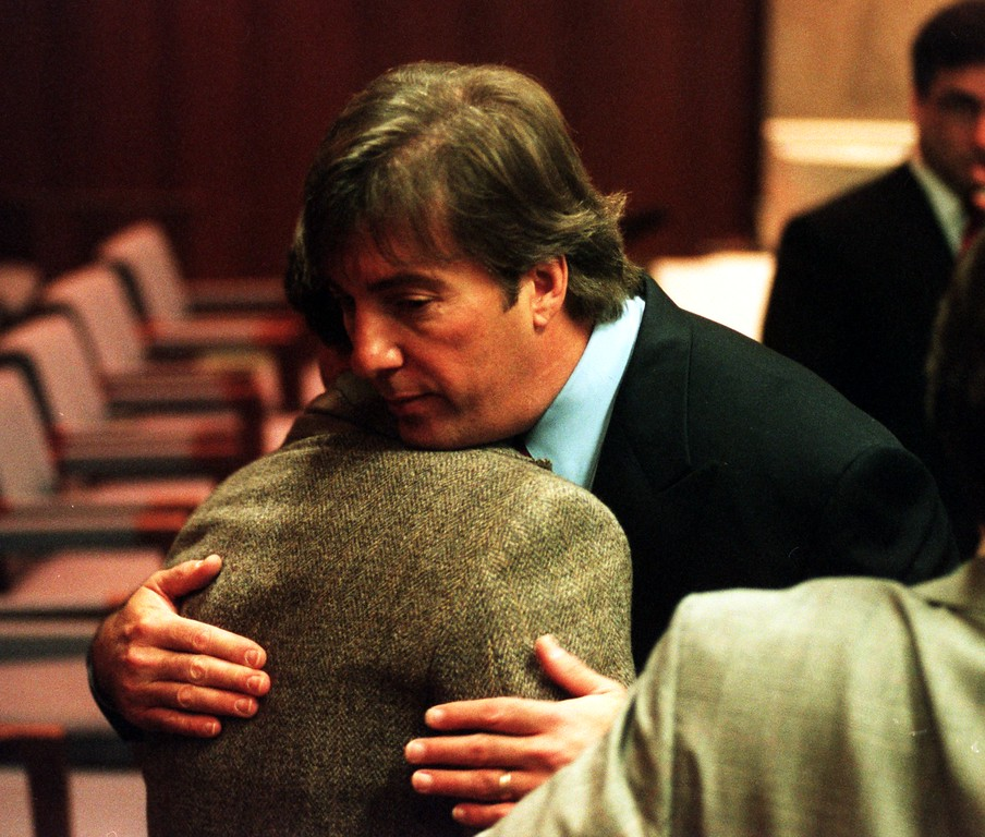 ". Attorney Geoffrey Fieger representing the Scott Amedure family hugs a family members after giving his opening statements in Oakland County Court, Pontiac, Mich. March 31, 1999 during the wrongful death lawsuit against ""The Jenny Jones Show\"" The family of Scott Amedure sued the show and its producers, contending they were responsible for setting in moting the event that led to Amedure\'s March 9, 1995, fatel shooting in his home."