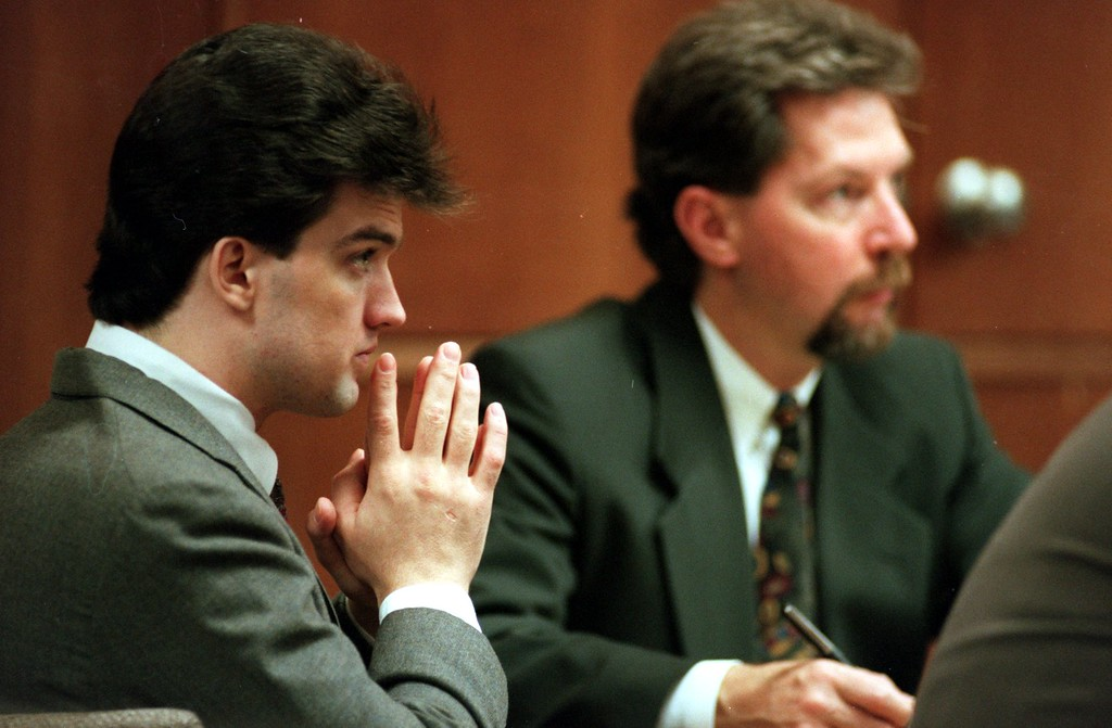 . Schmitz, left, sits in Oakland County Circuit Court during the Oct. 1996 trail for killing Scott Amedure.