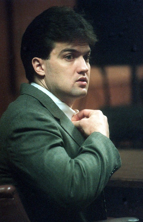 . Jonathan Schmitz adjusts his tie before the start of his retrial in the murder of Scott Amedure in Oakland County Circuit Thursday August 19, 1999. Schmitz shot and killed Amedure on March 9, 1995 a few days after it was revealed Amedure had a crush on Schmitz while both appeared on the Jenny Jones Show. (AP Photo/Vaughn Gurganian, Pool)