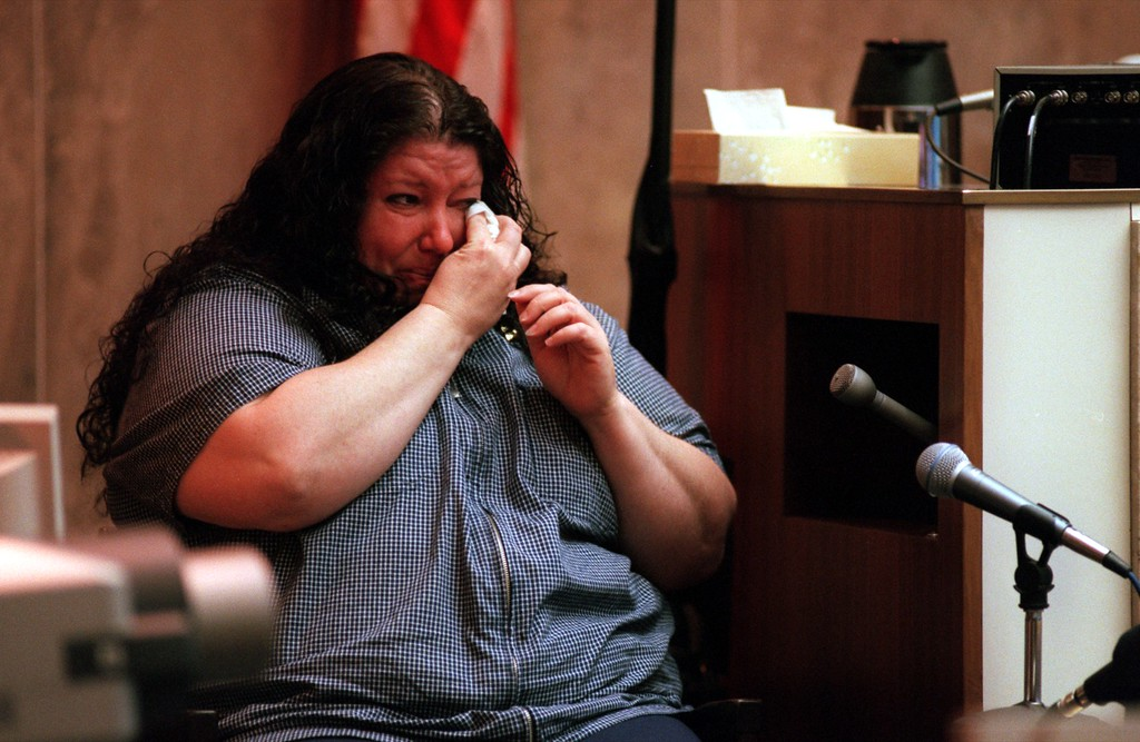 ". Donna Riley, a friend of both Scott Amedure and Jonsthan Schmitz cries as she testifies during the $50 million wrongful death suit brought by the family of Scott Amedure against ""The Jenny Jones Show\"" in Oakland County Circuit Court in Pontiac, Mich., Wednesday April 7, 1999.  The Amedure\'s family is suing the show distributor Warner Bros. and producer Telepictures Productions contending the show\'s \'ambush\' TV tactics drove Jonathan Schmitz to shoot Amedurein 1995 (AP Photo The Oakland Press, Charlie Cortez, Pool)"