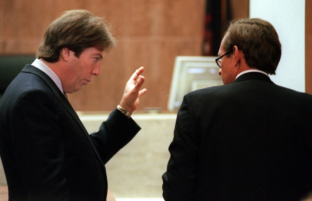 . Geoffrey Fieger, left, attorney for the family of Scott Amedure and James Feeney, attorney for Warner Bros. and the Jenny Jones Show argue in front of the judges bench during the $50 million wrongful-death suit brought by the family of Scott Amedure against The Jenny Jones Show in Oakland County Circuit Court in Pontiac, Mich., Wednesday  April 14, 1999. The Amedure\'s family is suing the show distributor Warner Bros. and producers Telepictures Production contending the show\'s ambush TV tactics drove Jonathan Schmitz to shoot Amedure 1995. (AP Photo/Charlie Cortez, Pool)