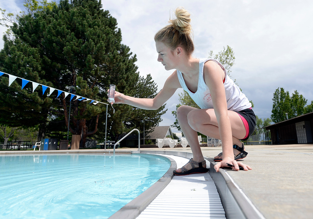 . Deck Supervisor Haylie Lengel tests the chlorine levels at the Scott Carpenter Park pool on Thursday in Boulder. Jeremy Papasso/ Staff Photographer/ May 25, 2017