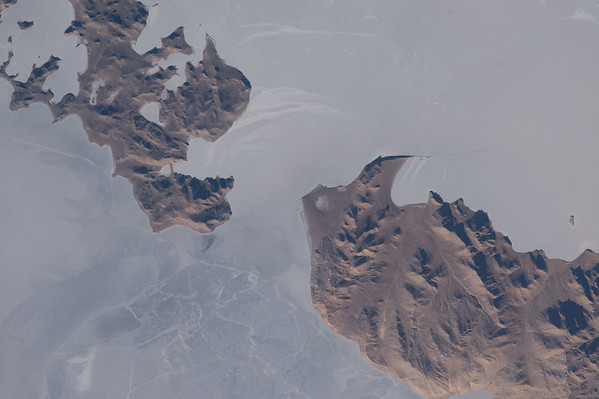 Good morning from #ISS. This high altitude Central Asian lake looks like my morning cereal. #BreakfastOfChampions