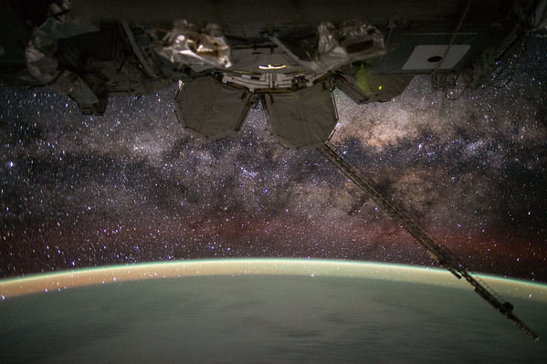 Day 135. #MilkyWay. You're old, dusty, gassy and warped. But beautiful. Good night from @space_station! #YearInSpace