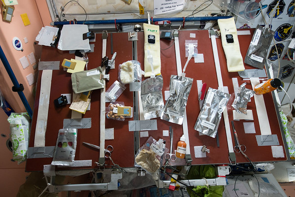 """Looks messy, but it's functional. Our #food table on the @space station. What's for breakfast? #YearInSpace """