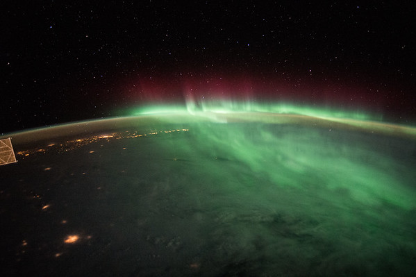 #NorthernLights mixed with the clouds below look rather imposing. #GoodMorning from @Space_Station! #YearInSpacef