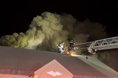 Smoke pours from the roof as firefighters open up to ventilate SENTINEL&ENTERPRISE/Scott LaPrade
