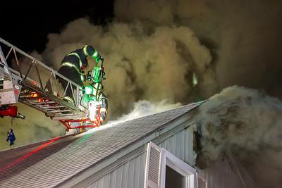 Firefighters open up the roof SENTINEL&ENTERPRISE/Scott LaPrade