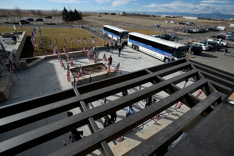 American flags decorate the grounds of Rex Church with two RTD busses parked in front during Scott VonLanken's memorial service Monday, Feb. 6, 2017, at Rez Church in Loveland. VonLanken, an RTD security officer, was killed while on duty in downtown Denver last week.  (Photo by Jenny Sparks/Loveland Reporter-Herald)