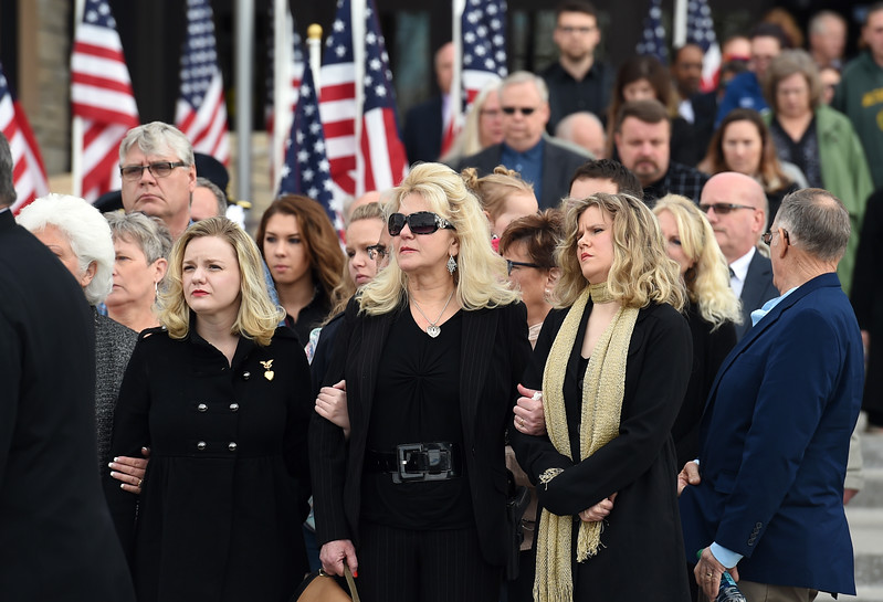 Shellie VonLanken, center, and her daughters Cassie and Crystal, watch as their husband and father, Scott VonLanken's casket is loaded into a hearse after his memorial service Monday, Feb. 6, 2017, at Rez Church in Loveland. VonLanken, an RTD security officer, was killed while on duty in downtown Denver last week.  (Photo by Jenny Sparks/Loveland Reporter-Herald)