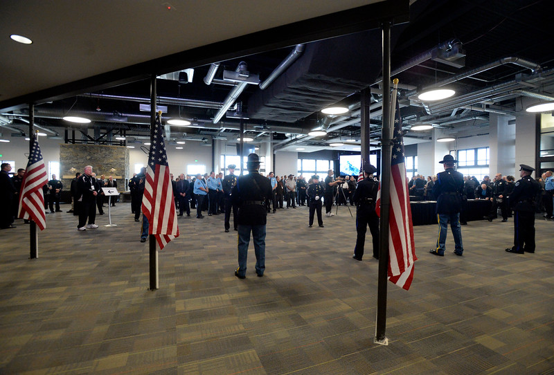 Law enforcement officers from accross the state fill the enrance to Rez Church before Scott VonLanken's memorial service Monday, Feb. 6, 2017, in Loveland. VonLanken, an RTD security officer, was killed while on duty in downtown Denver last week.  (Photo by Jenny Sparks/Loveland Reporter-Herald)