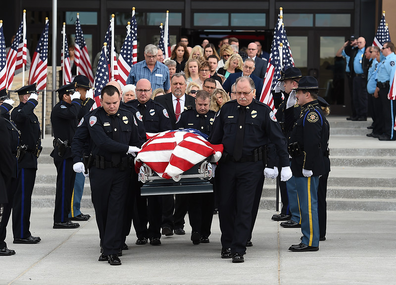 Allied United RTD secutiry officers carry Scott VonLanken's cakset to a hearse after his memorial service Monday, Feb. 6, 2017, at Rez Church in Loveland. VonLanken, an RTD security officer, was killed while on duty in downtown Denver last week.  (Photo by Jenny Sparks/Loveland Reporter-Herald)