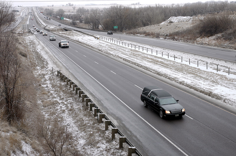 A hearse carrying the body of Scott VonLanken's casket drives in a procession on Interstate 25 in Loveland on Thursday, Feb. 2, 2017, to transport his body to a funeral home. VonLanken, an RTD  security officer, was killed Tuesday night while on duty at Union Station in Denver.   (Photo by Jeff Stahla/Loveland Reporter-Herald)