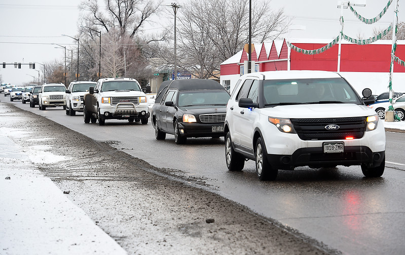 A procession with a hearse carrying the casket of Scott VonLanken drives on Lincoln Avenue in Loveland on Thursday, Feb. 2, 2017, on their way to Viegut Funeral home. VonLanken, an RTD security officer, was killed Tuesday night while on duty at Union Station in Denver.   (Photo by Jeff Stahla/Loveland Reporter-Herald)