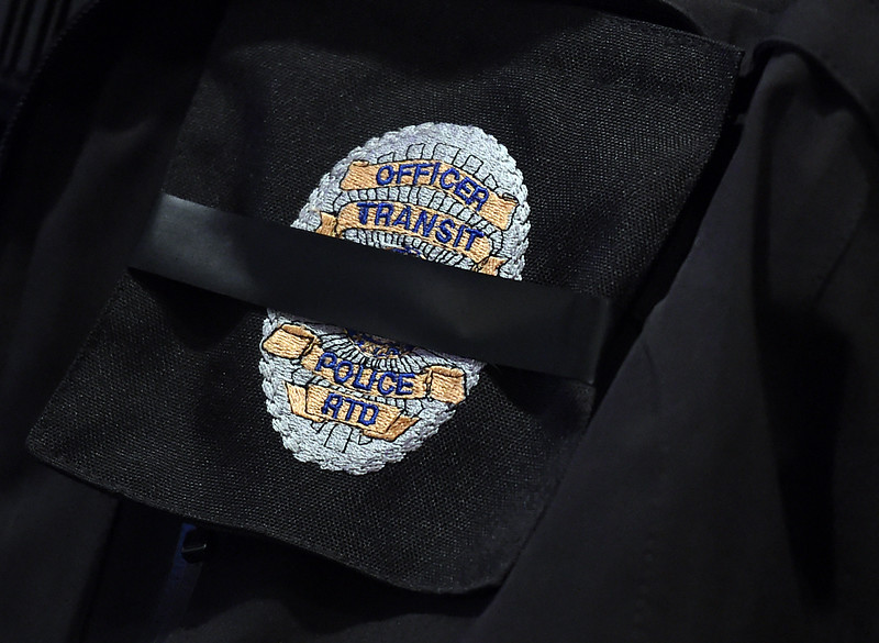 Black tape covers the badge of an RTD Security Officer with Allied <br /> United at Viegut Funeral Home in Loveland on Thursday, Feb. 2, 2017, after officers followed a procession from Denver carrying the body of their fellow officer, Scott VonLanken. VonLanken was killed Tuesday night while on duty at Union Station in Denver.   (Photo by Jenny Sparks/Loveland Reporter-Herald)