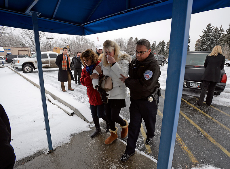 Shellie VonLanken, center, is comforted by Becky Salgado, left, a pastor with Resurrection Fellowship Church, and Commander Anthoy Vargas of Allied United RTD Security, as a hearse carrying the body of her husband, Scott VonLanken, arives at Viegut Funeral Home in Loveland on Thursday, Feb. 2, 2017. VonLanken, a security officer, was killed Tuesday night while on duty at Union Station in Denver.   (Photo by Jenny Sparks/Loveland Reporter-Herald)