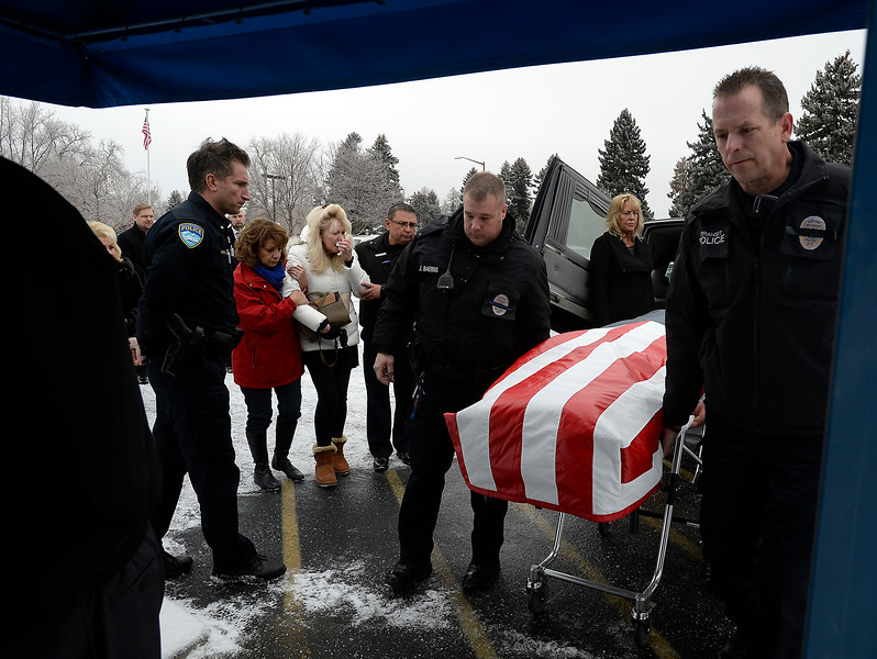 Shellie VonLanken, center left, is comforted by Becky Salgado, a pastor with Resurrection Fellowship Church, as RTD Security Officers with Allied <br /> United, carry her husband, Scott VonLanken's casket into Viegut Funeral Home in Loveland on Thursday, Feb. 2, 2017. VonLanken, a security officer, was killed Tuesday night while on duty at Union Station in Denver.   (Photo by Jenny Sparks/Loveland Reporter-Herald)