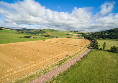 The new Borders Railway. Scene shows rail track and fields, towards the north at Bowshank farm
