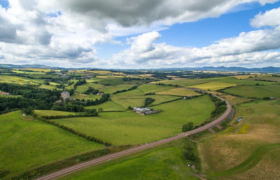 The new Borders Railway. Scene shows rail track, towards the north, with Borthwick Castle in the distance, at Borthwick.