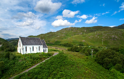 The Our Lady of the Braes church at Polnish. The church featured in the movie Local Hero. The West Highland Line rail track passes the church on the north side. Viewing west. Sunny day.