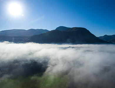 High above the River Lochy viewing towards Ben Nevis, on a misty morning with low hanging cloud.