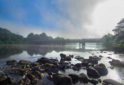The rail bridge over the River Lochy on a misty morning, viewing north