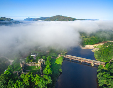 The rail bridge over the River Lochy and Old Inverlochy Castle. Viewing south towarsd Fort William, on a misty morning with low hanging cloud