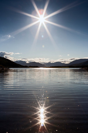 Sunbursts over Loch Leven