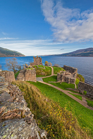 Urquhart Castle, situated on a headland overlooking Loch Ness, is one of the largest castles in Scotland.  The buildings of the castle were laid out around two main enclosures on the shore of Loch Ness.  The photographs in this series look northward up Loch Ness, taking in the Tower House and the North Lodge.