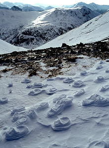 Ghostly footsteps on the Mamores.  mid-day, 09/02/79  ~ This was the occasion of my first winter Munros (Coirean and Stob Ban), so I assumed that these negative footprints were a common occurence, but I've never subsequently come across such a striking example of them.