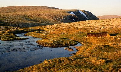 My favourite summer campsite in the Cairngorms.  9pm, 24/06/95  ~ By the side of what every writer calls 'the infant Dee', not far back from where it tumbles over the edge, down into the Garbh Choire Dhaidh. The ample clear running water at little less than 4000' is a luxury unique in this country.