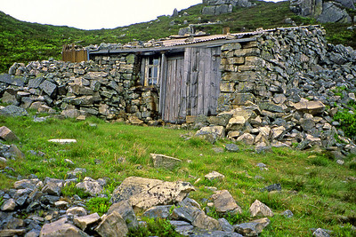 Near the top of a hill in the Schiehallion area.  19/06/04   ~  A curious rough-hewn structure which gives the impression that a rockfall has been invested with the vital spark and has heaved itself into the semblance of a bothy.